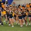 The Kent State cheerleaders lead the golden Flashes onto the field for a home football game during the 2009 season.